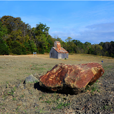 Rock in front of a classic house. Diamonds State Park