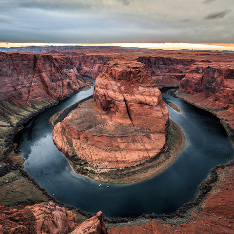 aerial view on the grand canyon water surrounding the bottom