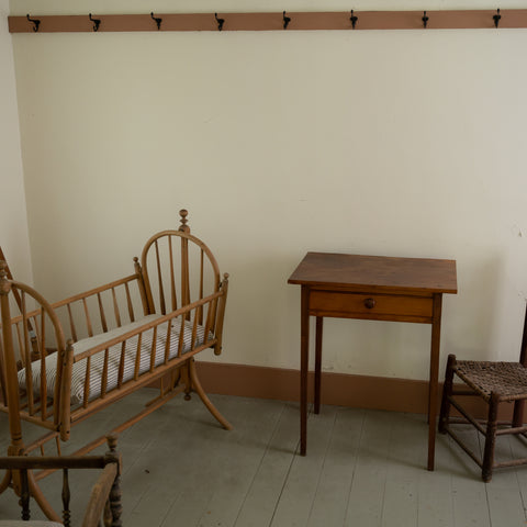 historic crib and little children's chair in the Herbert Hoover National Historic Site