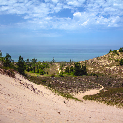 in-between two sand dunes on a path to the water at Indiana Dunes National Park