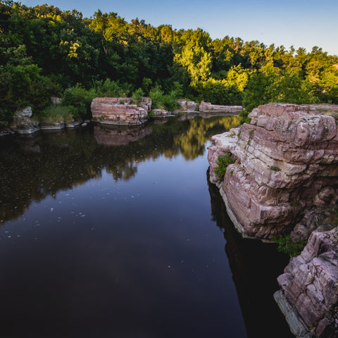 on a rock cliff over water at Palisades State Park