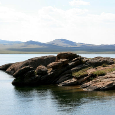 Eleven Mile Reservoir with rock outcropping in foreground at Eleven Mile State Park, Colorado
