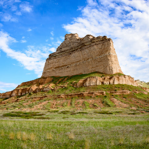 on a hike in a green field near Scotts Bluff National Monument