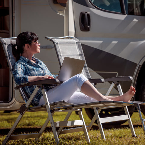connecting to the wifi while lounging in a chair at the RV Park
