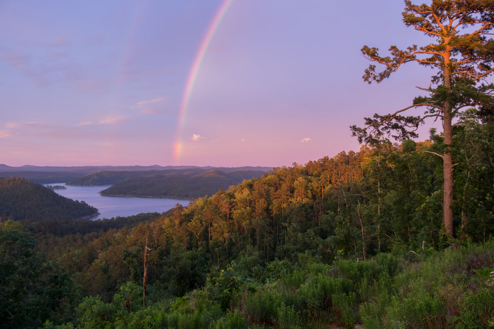 A View of Rainbow Over Lake and Mountains at Beavers Bend State Park Oklahoma