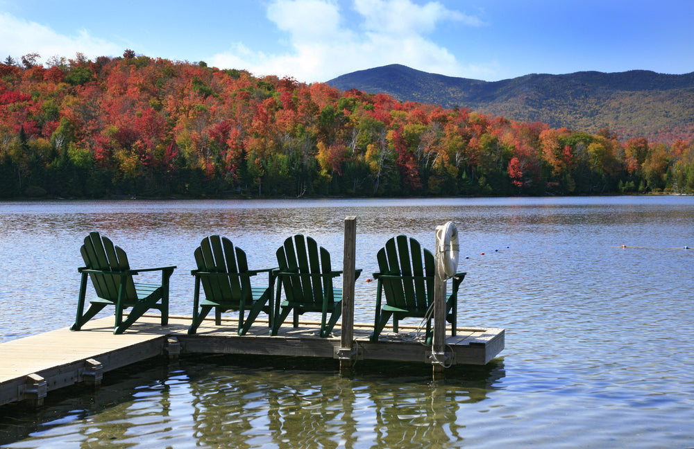 Adirondack Chairs on a Dock at Lake in Adirondack State Park New York