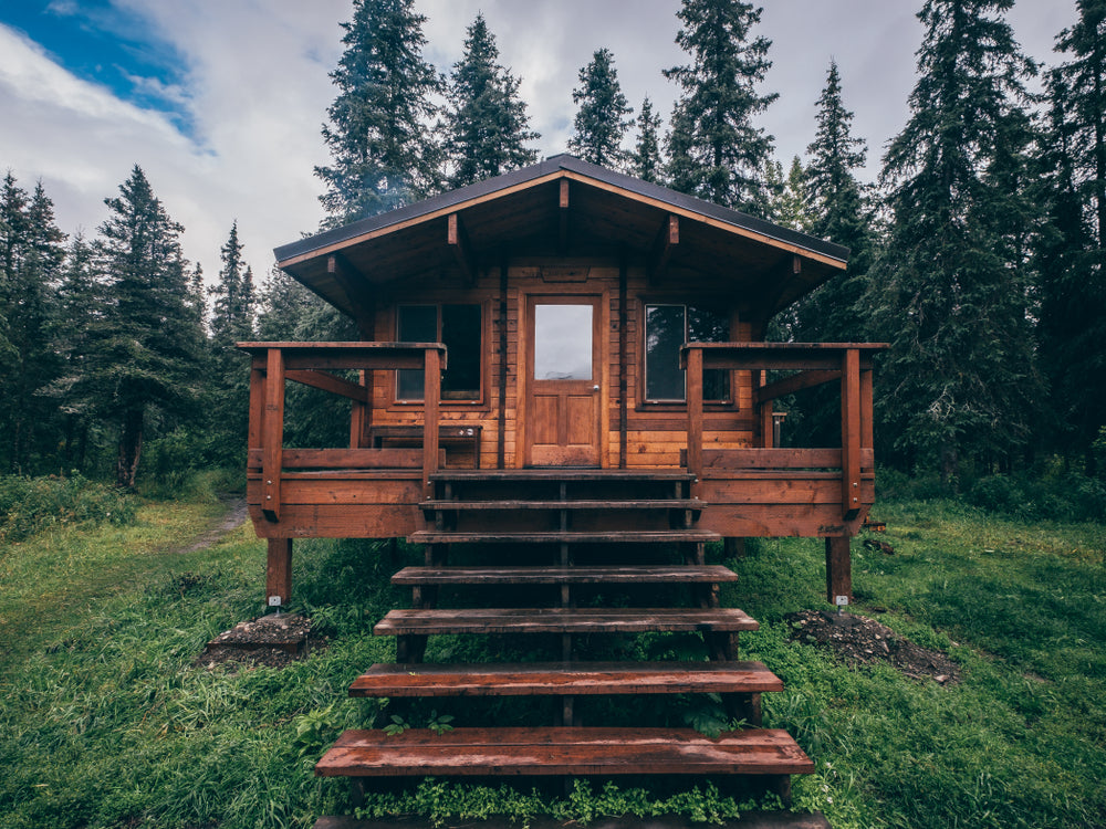 Beautiful wooden cabin next to forest in Chugach State Park Alaska