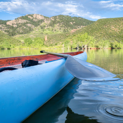 Sunny day with Canoe on Horseshoe Reservoir in Lory State Park, Colorado
