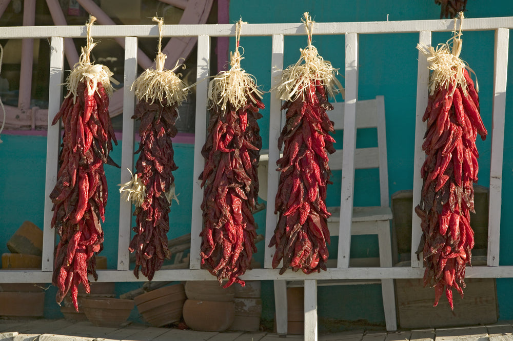 Chili Peppers Drying in The Sun on Porch in Alto New Mexico