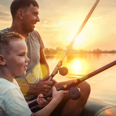 father son fishing while camping