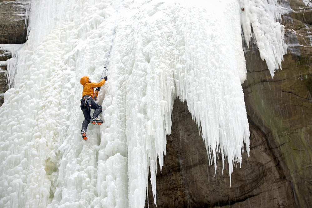 Frozen Waterfall with Person Climbing it in Tonty Canyon in Starved Rock State Park Illinois