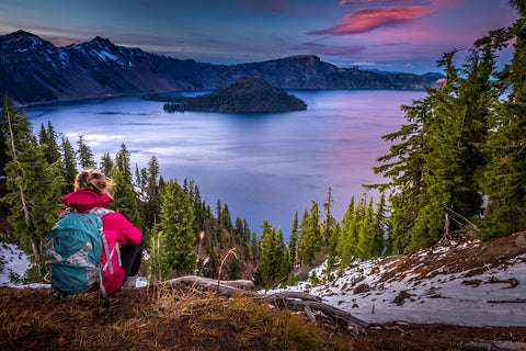 Hiker on Wizard Island Overlooking Crater Lake During Sunset in Crater Lake National Park