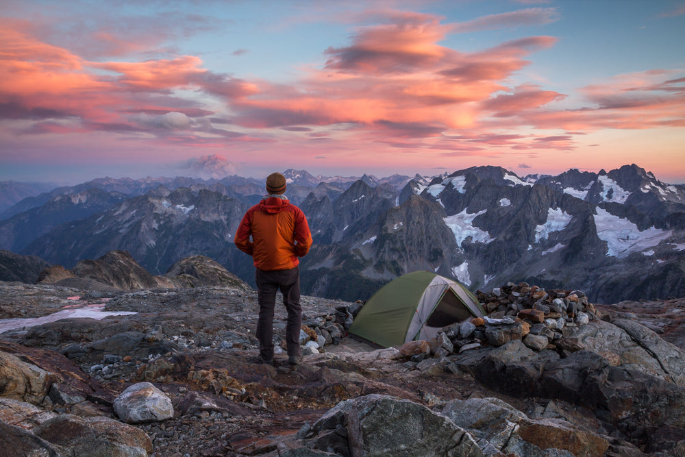Hiker Overlooking Sunset View of North Cascades National Park