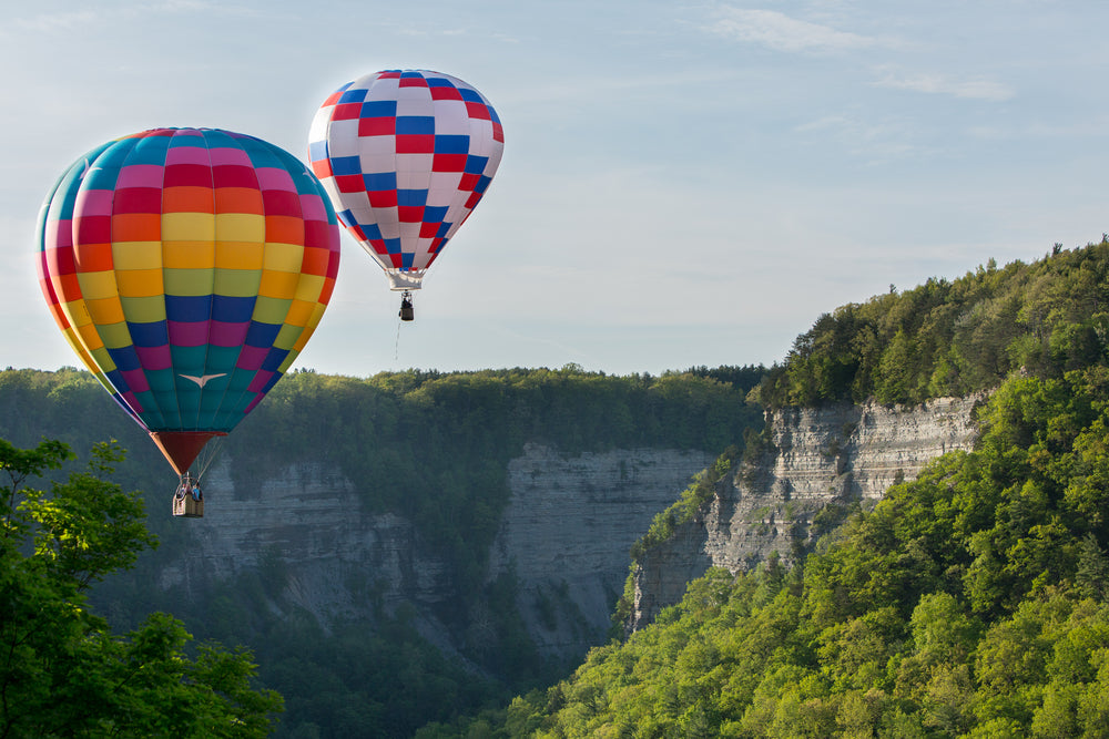 Hot air balloons floating over the gorge at Letchworth State Park