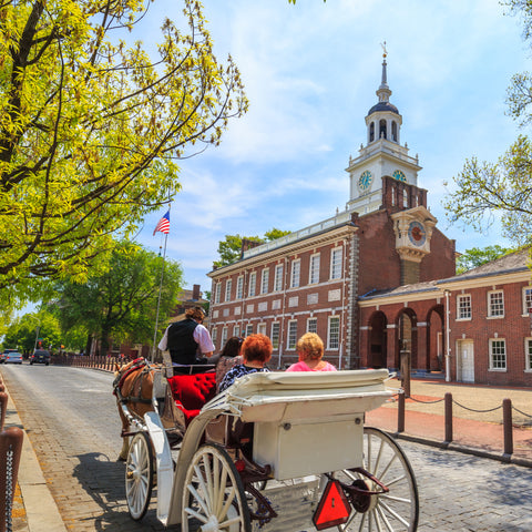 Horse carriage going past Independence Hall in Independence National Historical Park