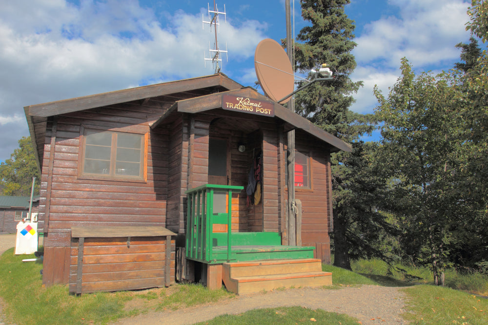 Katmai Trading Post Rangers Brown Wooden Cabin With Satellite Dish in Katmai National Park