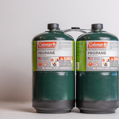 propane cans green and white perfect for camping