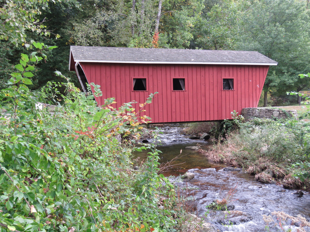Red Covered Bridge Over Stream in Kent Falls State Park Connecticut
