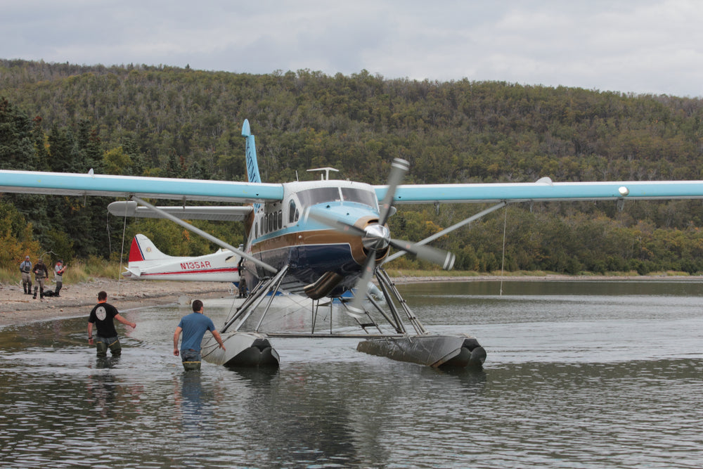 Sea Plane Floating in Lake Men Preparing for Take Off Out of Katma National Park