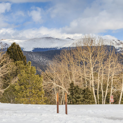 Snowy landscape with green mountains in the distance at Mueller State Park, Colorado