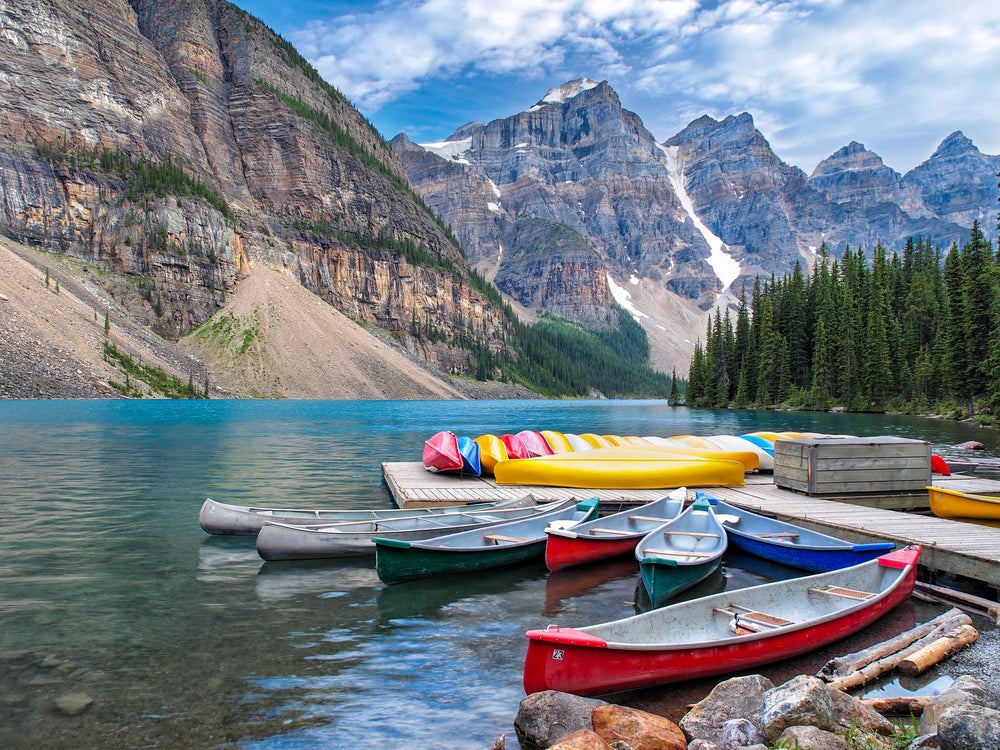 Sunny Day View of Canoes on Moraine Lake Rocky Mountain National Park