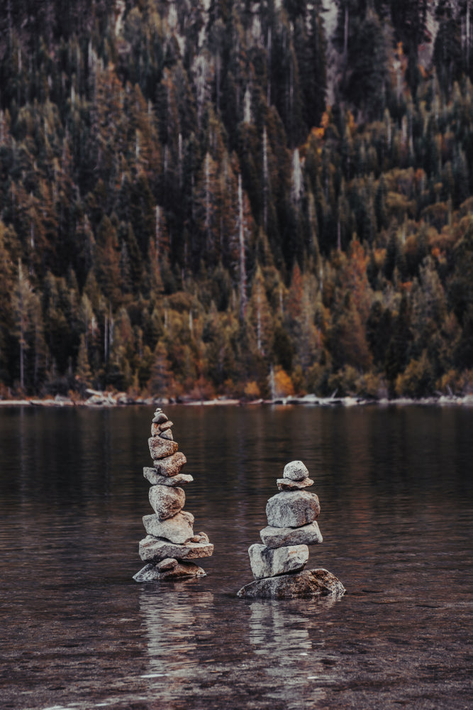 Two Cairns Tall Stacked Rocks Sitting in Emerald Bay