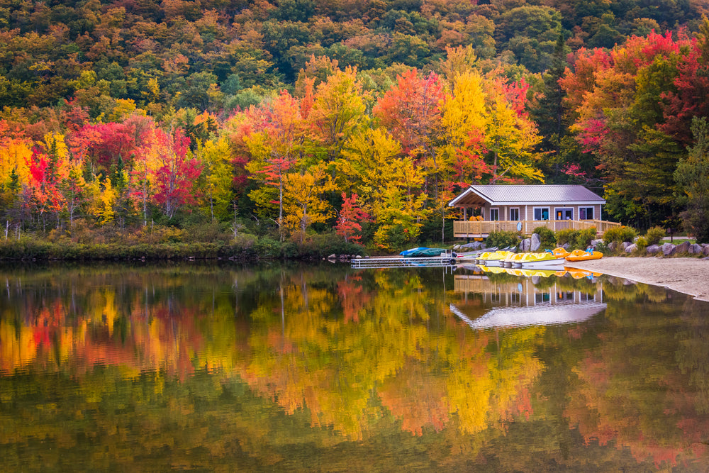 View of Boathouse and Fall Colors Reflecting in Echo Lake in Franconia Notch State Park New Hampshire