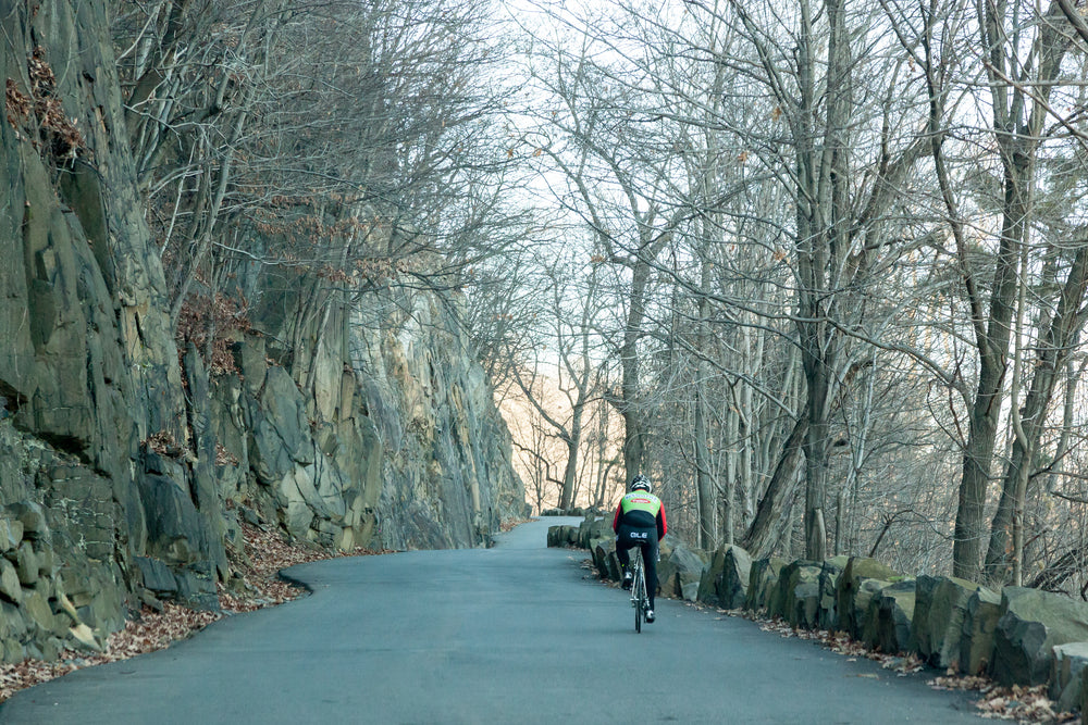 View of Cyclist Along Roadway in Palisades Interstate Park New Jersey