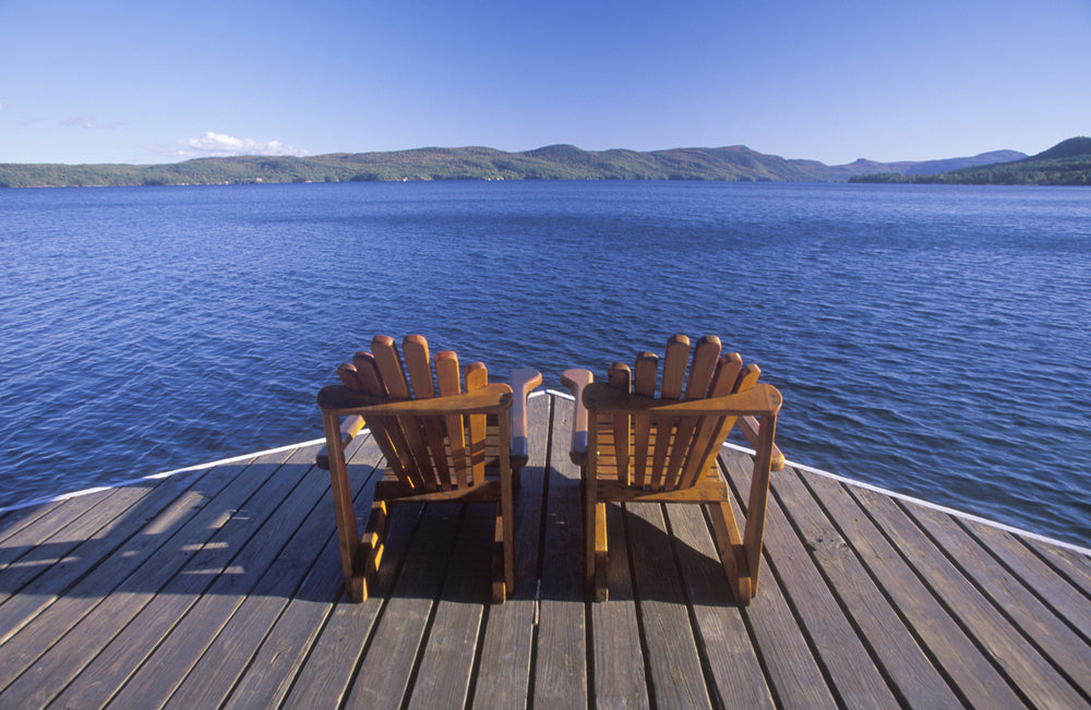 View of Lake George With Adirondack Chairs on a Deck at Lake George RV Park New York