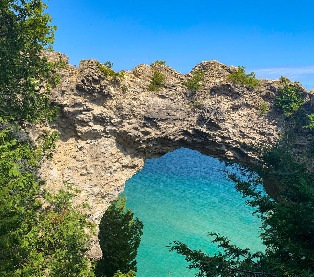 view-of-lake-huron-through-hole-in-arch-rock-on-mackinac-island-state-park-michigan
