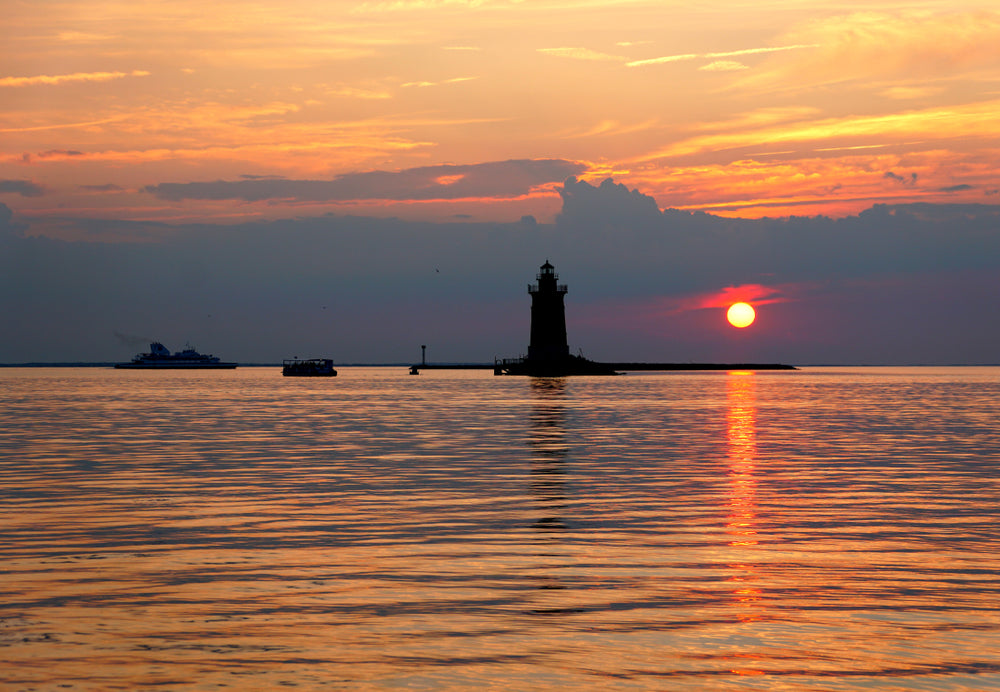 View of Lighthouse and Boats During Sunset at Cape Henlopen State Park Delaware