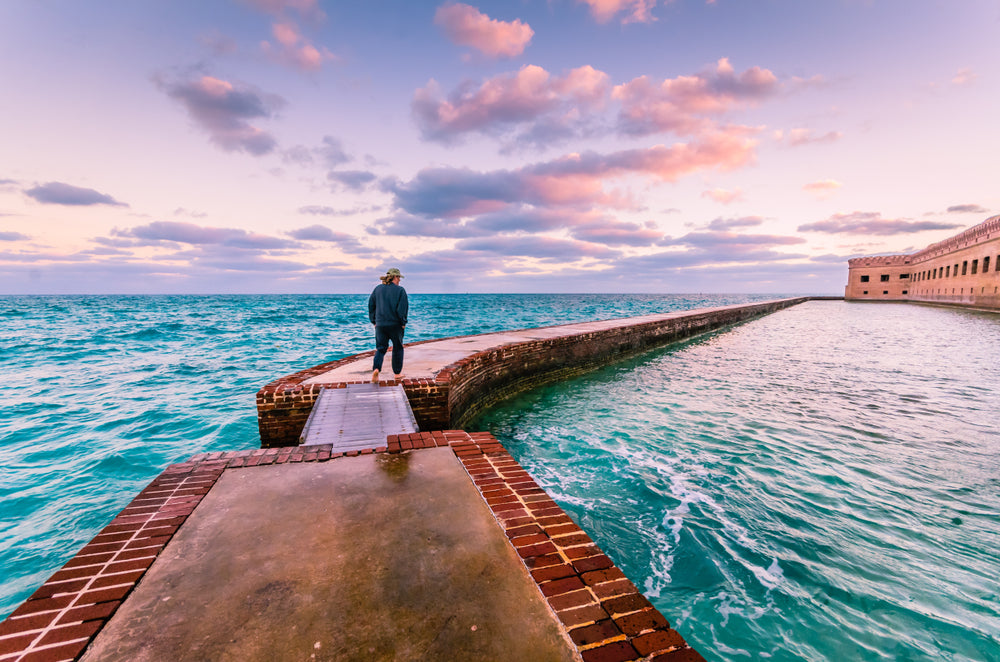 View of Man Walking on Moat Around Fort Jefferson in Dry Tortugas National Park Florida