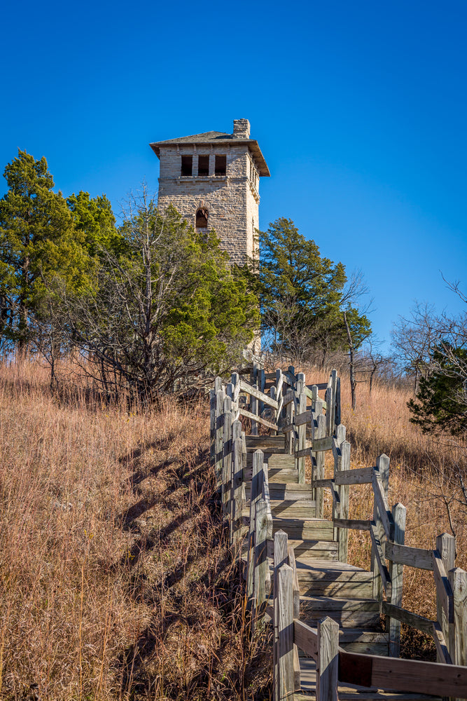 View of Wooden Staircase and Stone House on Sunny Day Ha Ha Tonka State Park