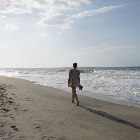 walking on the beach at  Sea & Sand RV Park Visitors Guide