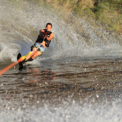 water skiing on the lake on a summer day