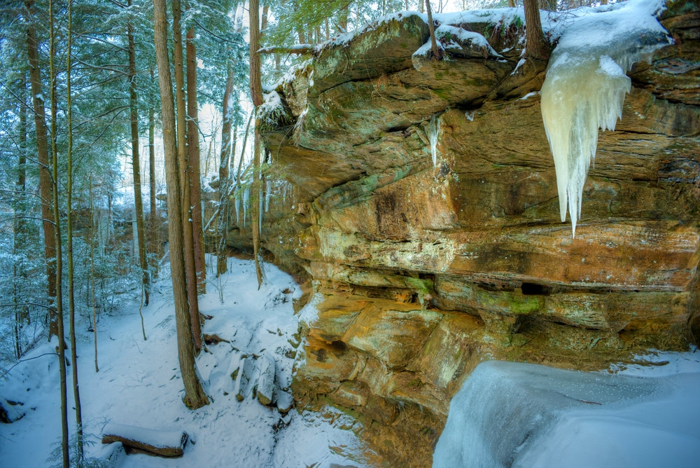 Winter View of Icy Covered Rocks and Snow Covered Trees in Hocking Hills State Park Ohio