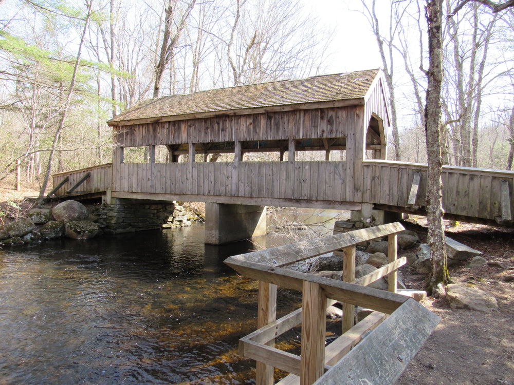 Wooden Covered Bridge over Stream in Devils Hopyard State Park Connecticut