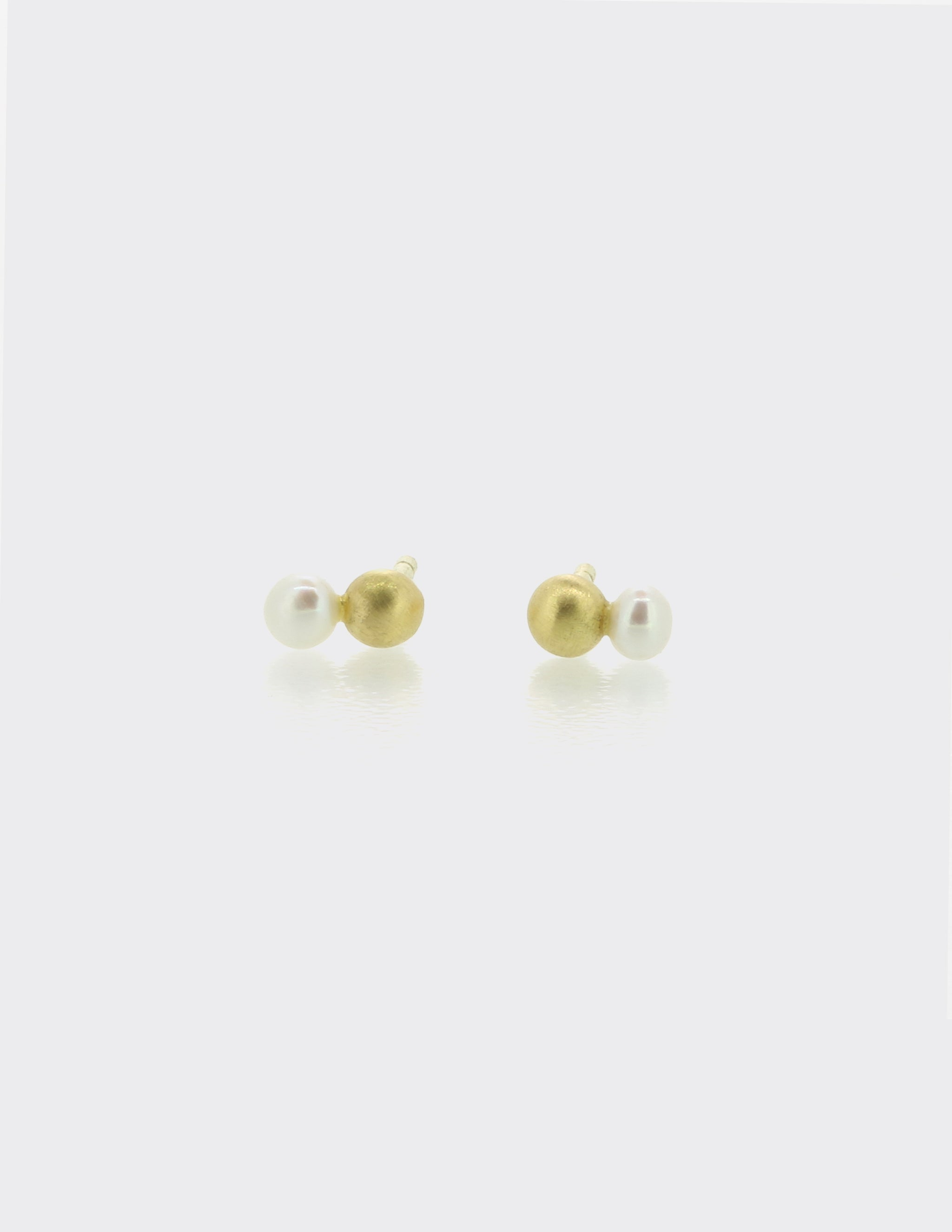 Gold and pearl ear studs