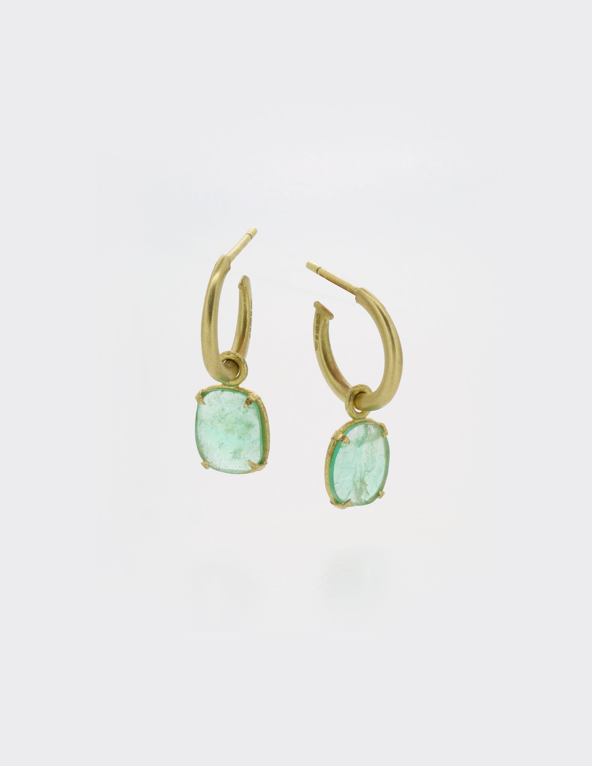 Emeralds on gold hoops