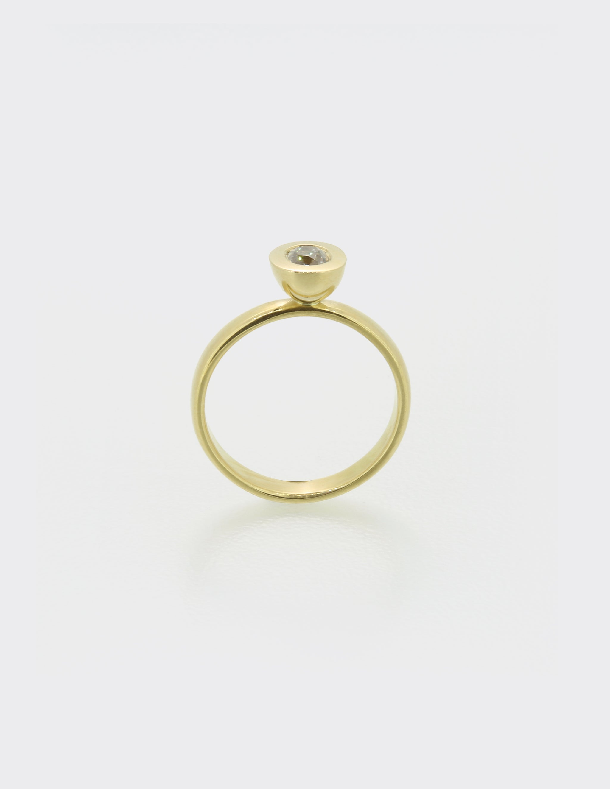 Cone ring with oval diamond