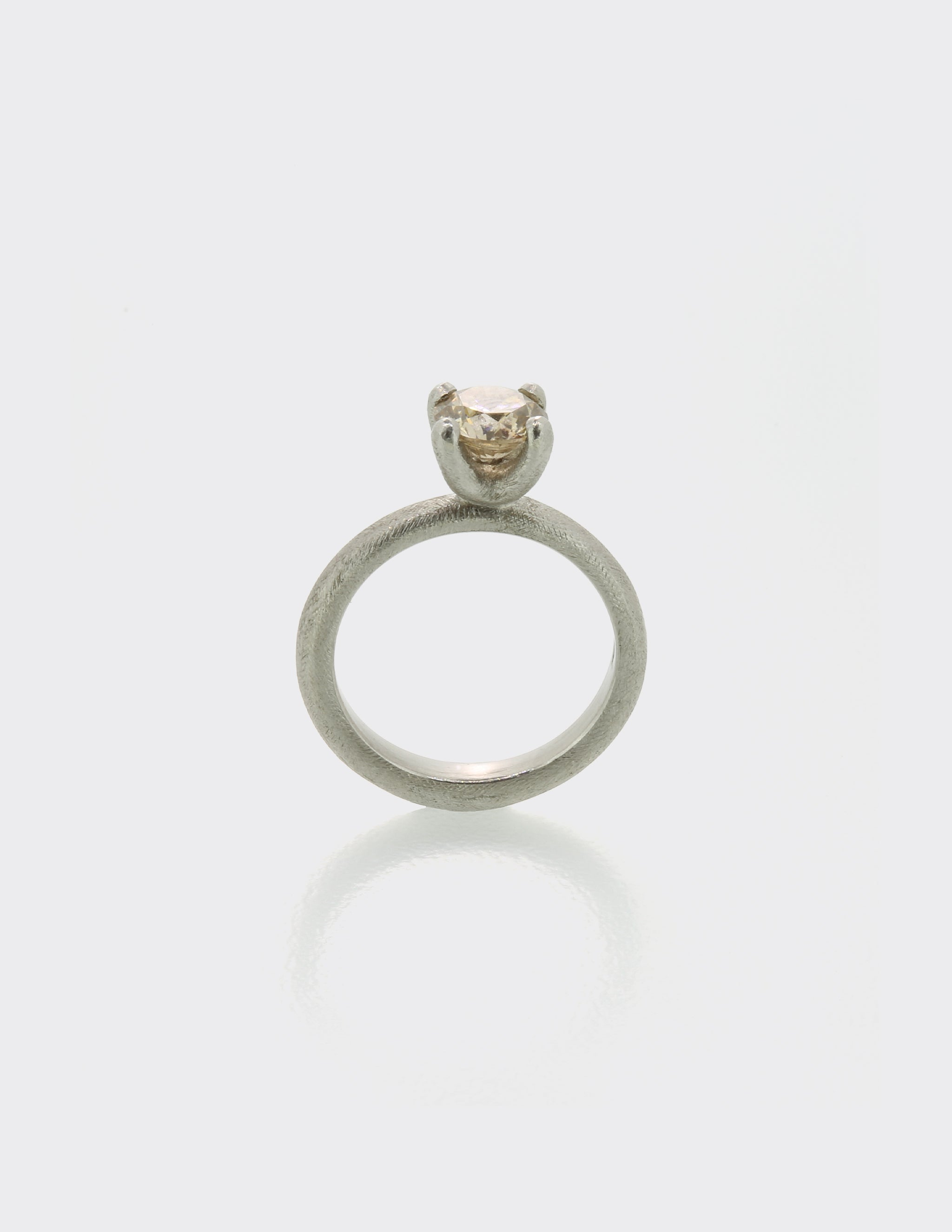 Platinum and pale brown diamond ring