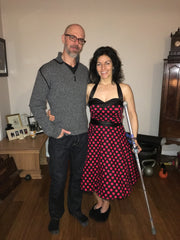 My fellow and me in my 50s dress, and my crutch on party night