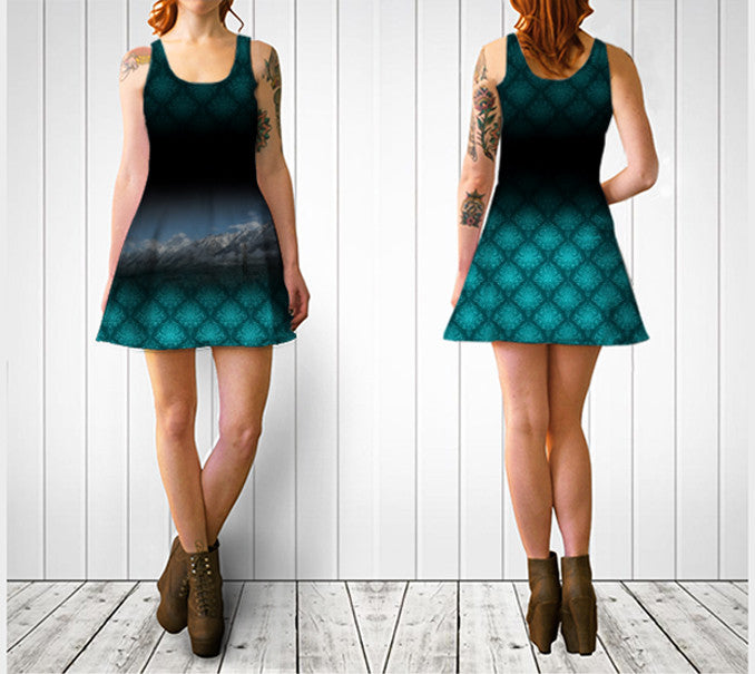 Mountains at Canmore on a dark dress with aqua detailed swirly pattern