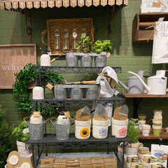 Garden planters and gift items displayed on potting table