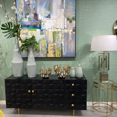 Sage green walls with matte black console