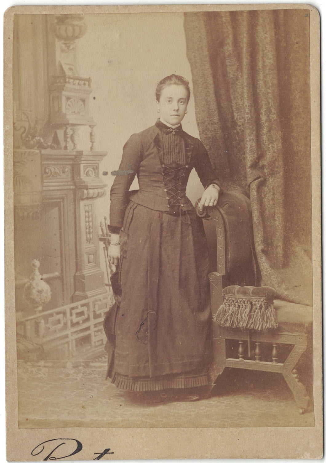 Antique photograph young woman in mourning clothing.
