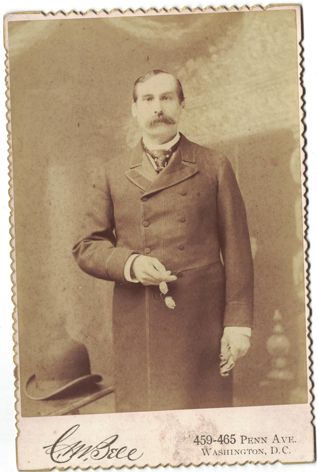 Antique cabinet card photograph man holding glasses and gloves taken in Washington, DC