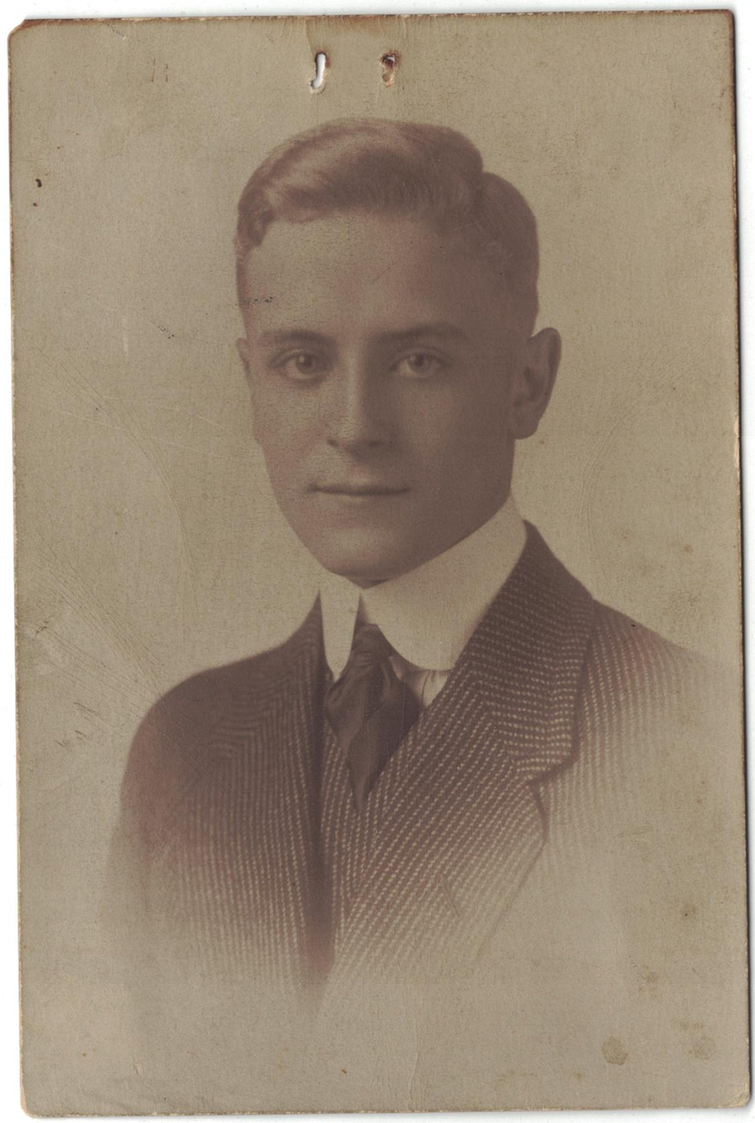 Vintage photograph handsome man in striped suit.