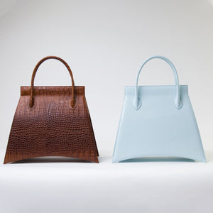 Collection of MIDI BLANKET Bag, a tote bag with minimalist look and available in brown and blue variants