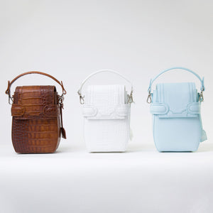 Collection of OCTAVIO 4 WAY BACKPACK, a fashionable backpack with minimalist look available in brown, blue and white